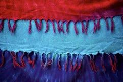 用穗缨装饰的领带染料背景布料 库存照片