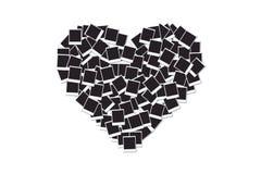 用空白的立即照片框架做的心脏,被隔绝在白色 库存图片