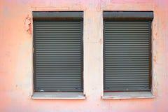 用窗帘盖的两个窗口 图库摄影