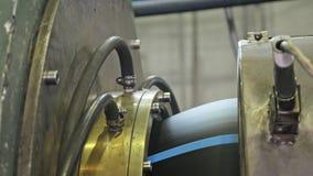用管道输送制造生产线 塑料水管工厂制造  做塑料管的过程在 免版税库存照片