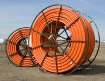 用管道输送塑料轮子 免版税库存照片
