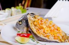 用米盘充塞的开胃烤鱼 免版税图库摄影