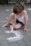 用粉笔写的女孩街道 免版税库存图片