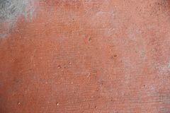 用红色灰泥盖的老土气墙壁纹理  库存照片