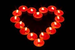 用红色蜡烛做的心脏 图库摄影