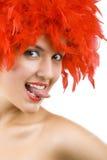 用羽毛装饰女孩华美的红色年轻人 库存照片