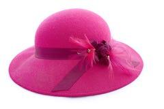 用羽毛装饰的帽子粉红色葡萄酒 库存图片