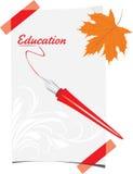 用羽毛装饰笔和纸板料与枫叶 库存图片