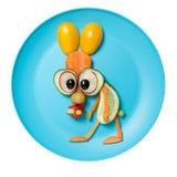 用菜做的兔子在蓝色板材 免版税库存照片