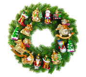用装饰品、中看不中用的物品和葡萄酒装饰的圣诞节花圈t 免版税库存图片