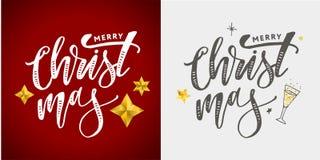 用金黄装饰的圣诞快乐书法题字 库存照片