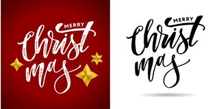 用金黄装饰的圣诞快乐书法题字 免版税库存照片