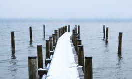 用雪包括的码头 免版税库存图片