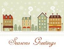 用雪包括的逗人喜爱的小的城镇 免版税库存照片