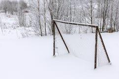 用雪报道的足球目标 免版税图库摄影