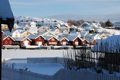 用雪盖的船库 免版税图库摄影