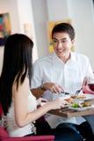 用餐与合作伙伴的人 库存图片