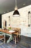 用餐玻璃空间圆桌的接近的刀叉餐具 土气的家具 免版税库存照片