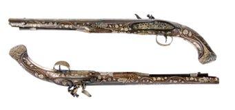 用骨头和搪瓷镶嵌的老手枪 免版税库存图片