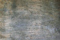 用黑小点和镇压报道退色的胶合板板的被构造的背景  免版税图库摄影