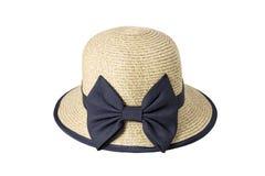 用黑布料装饰的被编织的帽子栓与丝带 免版税库存照片