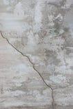 用水泥涂有镇压和老油漆纹理的墙壁 免版税库存照片