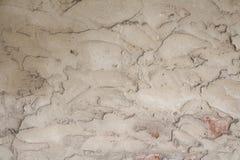 用水泥盖的灰色墙壁 概略的纹理 图库摄影