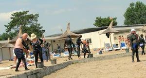 用治疗泥盖的人们在泰基尔吉奥尔 免版税库存照片