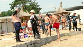 用治疗泥盖的人们在泰基尔吉奥尔 免版税库存图片