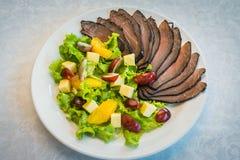 用绿色装饰的语言开胃菜,欢乐事件的冷盘 库存照片