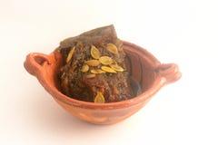 用piloncillo和cinammon做的墨西哥传统南瓜甜点在泥罐,叫作calabaza en tacha 免版税库存图片