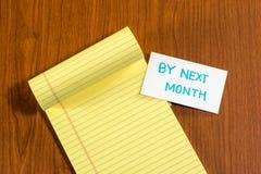 由下个月;与小消息卡片的白色空白文件 库存图片
