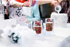 由与莓果圆滑的人的冰做的三块玻璃线在 免版税库存图片