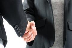 由两名妇女的企业握手 免版税库存图片