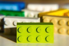 由乐高集团的五颜六色的乐高砖在白色背景隔绝了 图库摄影