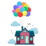 由五颜六色的气球的议院飞行 免版税图库摄影