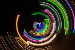 由五颜六色的背景的照相机运动的轻的绘画 免版税库存照片