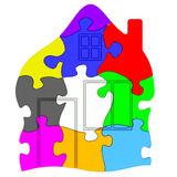 由五颜六色的难题做的房子的标志 库存照片