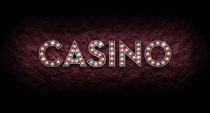 由光亮的光做的赌博娱乐场标志 库存照片