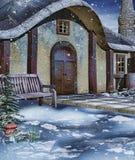 由冬天村庄的长凳 免版税库存照片