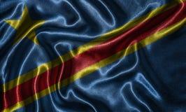 由刚果民主共和国旗子和挥动的旗子b贴墙纸 库存照片