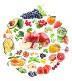 由各种各样的蔬菜和水果盘旋形状形式 免版税库存图片