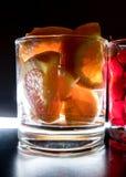 由后照的饮料的桔子 库存图片