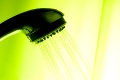 由后面照的淋浴喷头 免版税库存照片