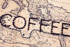 由咖啡豆做的字咖啡 免版税库存照片