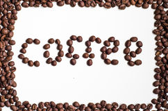 由咖啡豆的文本 免版税库存照片