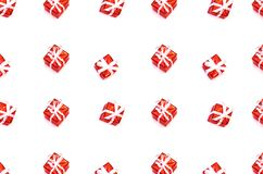 由圣诞礼物箱子做的样式被隔绝在白色 免版税库存照片