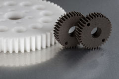 由塑料做的工业齿轮 免版税库存照片