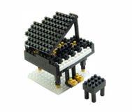 由塑料玩具块做的钢琴玩具 免版税库存图片