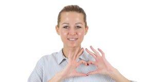 由妇女,白色背景的手工制造心脏 库存图片
